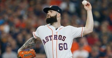 Dallas Keuchel delivers a pitch for the Houston Astros in the 2018 MLB playoffs.
