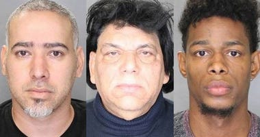 Cops say three men were running a heroin ring out of a Long Island barber shop.