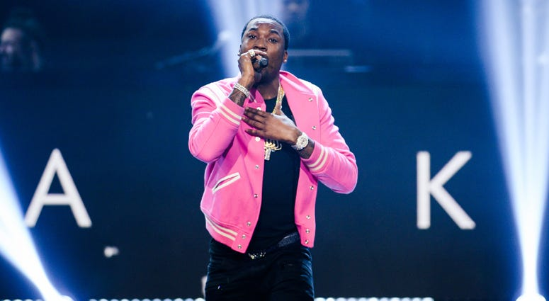 "NEW YORK CITY - NOVEMBER 30: Meek Mill appears onstage at ""Showtime at the Apollo"" at the Apollo Theater on November 30, 2016 in New York City."