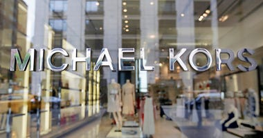 FILE- In this May 31, 2017, file photo the Michael Kors name adorns his store on Madison Avenue, in New York.