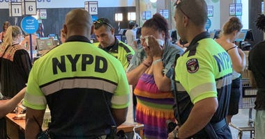 Police officers buy groceries for woman accused of shoplifting