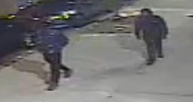 Cops are looking for the guys involved in a gunfight that left an off duty officer with a graze wound.