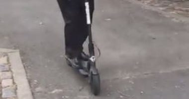 1010 WINS' Al Jones rides an electric scooter.