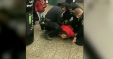 Woman arrested face mask subway
