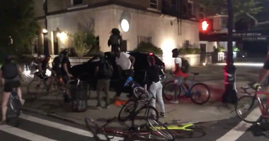 Video shows the SUV driving through protesters