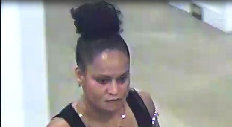 Cops are looking for a woman who bit a Macy's employee after being confronted for shopiftng.