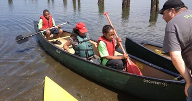 Kids kayaking at NYC Parks summer camp