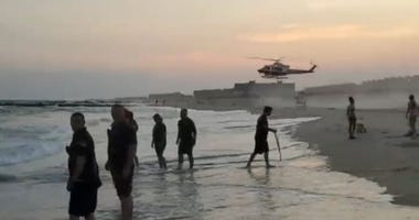 Search on Rockaway Beach for missing swimmers