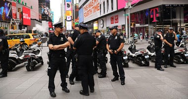 Police after arrest of suspected Times Square terrorist