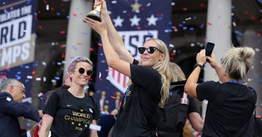 United States women's national soccer team midfielder Allie Long (20) celebrates with the trophy at New York City Hall after the ticker-tape parade for the United States women's national soccer team down the canyon of heroes in New York City