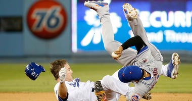 Chase Utley of the Los Angeles Dodgers breaks the leg of New York Mets shortstop Ruben Tejada on a slide during the 2015 MLB playoffs.