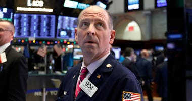 Wall Street's wild Christmas week goes on, with the Dow Jones Industrial Average slumping 300 points at the open Thursday, a day after notching its biggest-ever point gain.