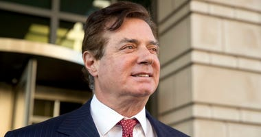 FILE - In this Thursday, Nov. 2, 2017, file photo, Paul Manafort, President Donald Trump's former campaign chairman, leaves Federal District Court, in Washington.