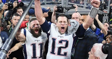 Julian Edelman #11 of the New England Patriots and teammate Tom Brady #12 celebrate at the end of the Super Bowl LIII at Mercedes-Benz Stadium on February 3, 2019 in Atlanta, Georgia. The New England Patriots defeat the Los Angeles Rams 13-3.