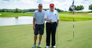 President Donald J. Trump poses for a photo with football legend Brett Favre at Trump National Golf Club in Bedminster Saturday, July 25, 2020, in Bedminster, N.J.  Official White House Photo by Tia Dufour