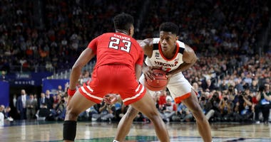 Texas Tech's Jarrett Culver guarding Virginia's Deandre Hunter in the NCAA championship game