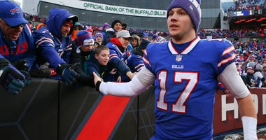 Buffalo Bills quarterback Josh Allen (17) greets fans following the game against the Miami Dolphins at New Era Field.