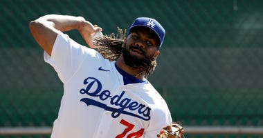 Dodgers' Kenley Jansen reports to camp after having COVID-19