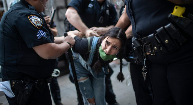 The Latest: 1,400 arrests in 17 cities during protests | 1010 WINS