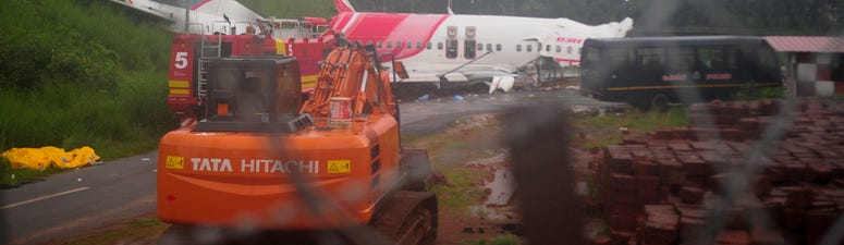 Plane skids off runway in India; 17 killed, including pilots