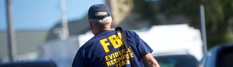 Man Arrested for Hoarding Masks, Coughing on FBI Agents