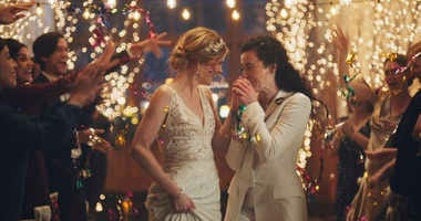 Hallmark pulls gay-themed wedding ads, sparking backlash