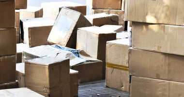 A stack of packages in a warehouse, ready for delivery.