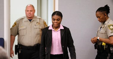 Tiffany Moss enters court to hear the sentencing verdict on Tuesday, April 30, 2019, in Lawrenceville, Ga