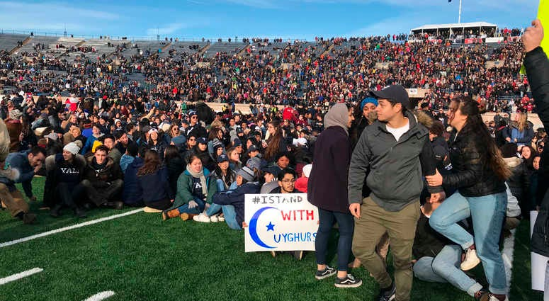 Climate protest Yale Harvard game