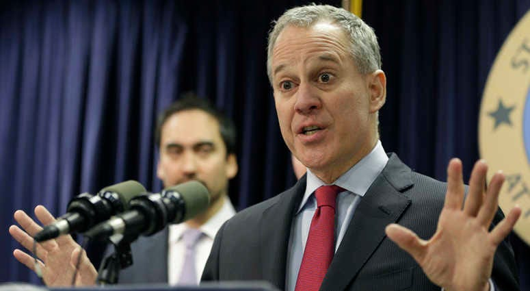 FILE - In this March 21, 2016, file photo, New York Attorney General Eric Schneiderman speaks during a news conference in New York.