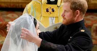 Britain's Prince Harry pulls back the veil of Meghan Markle during their wedding at St. George's Chapel in Windsor Castle in Windsor.