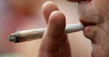 Man smokes marijuana joint