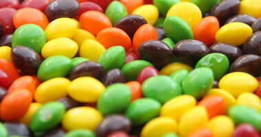 A closeup of a bowl of Skittles.