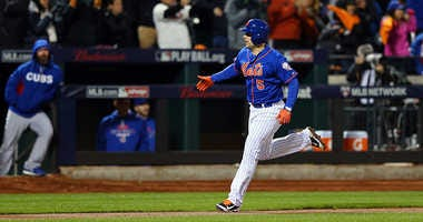 David Wright celebrates after scoring off of Daniel Murphy's two run home run in the first inning against Jake Arrieta of the Chicago Cubs during game two of the 2015 NLCS