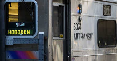 A New Jersey Transit train arrives at Hoboken Terminal during morning rush hour