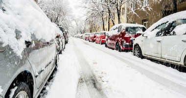Cars on a snowy city street