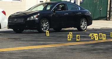 A 48 yr old man sitting in this black Nissan was shot multiple times in his torso and died today.