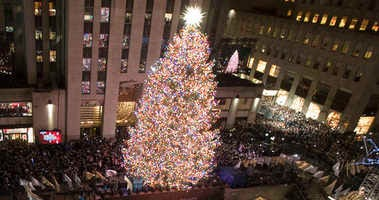 The Rockefeller Center Christmas tree is lit during the 86th annual Rockefeller Center Christmas tree lighting ceremony, Wednesday, Nov. 28, 2018, in New York.