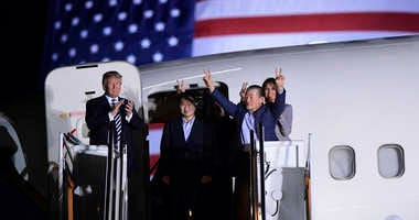 President Donald Trump, from left, greets Tony Kim, Kim Hak Song, seen in the shadow, and Kim Dong Chul, three Americans detained in North Korea for more than a year, as they arrive at Andrews Air Force Base in Md., Thursday, May 10, 2018.