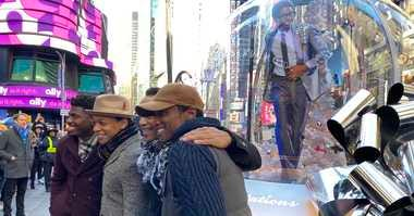 'Ain't Too Proud' cast in front of show globe