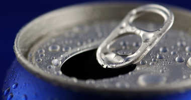 Open Aluminum Soft Drink Can With Water Drops.