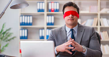 A man wearing a blindfold.