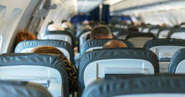 Inside of the plane with passengers.