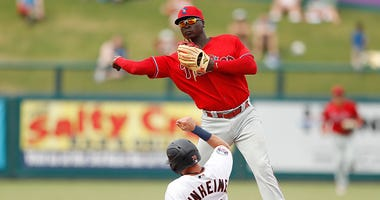 Didi Gregorius turns two for the Phillies in spring training.