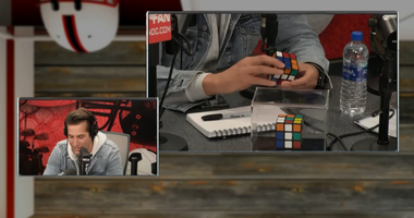 Max Major stuns The Sports Junkies with wild Rubik's Cube trick.