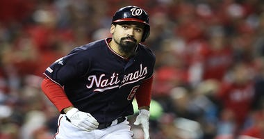 Washington Nationals third baseman Anthony Rendon runs down the line after batting.
