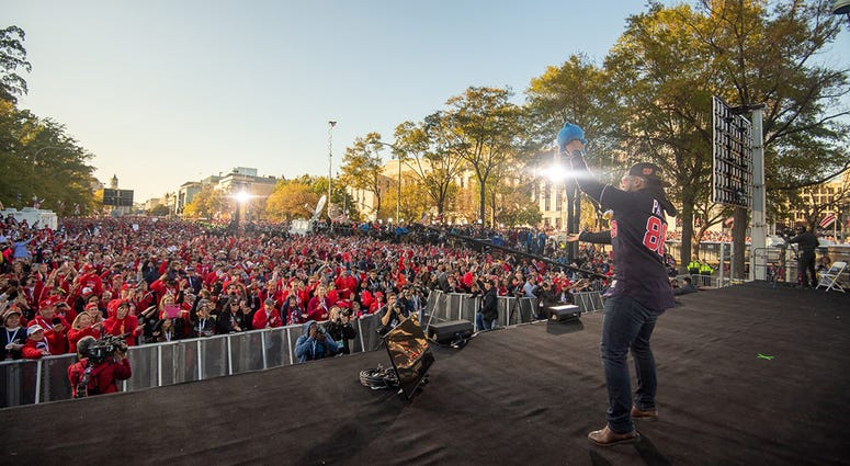 Washington Nationals players and coaches roll through the streets of Washington, D.C. and then speak on stage, celebrating their 2019 World Series championship with a few hundred thousand fans on November 2, 2019.