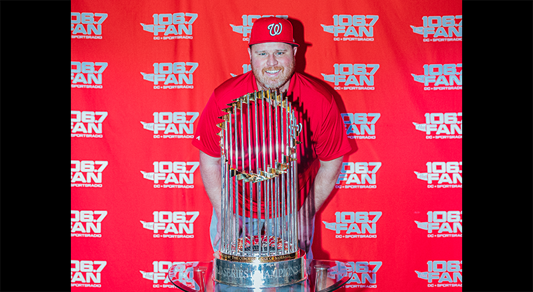 Senior 106.7 The Fan writer Chris Lingebach poses with the World Series Trophy