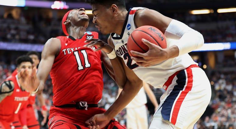 Rui Hachimura drives against Tariq Owens of Texas Tech in the 2019 NCAA Men's Basketball Tournament West Regional