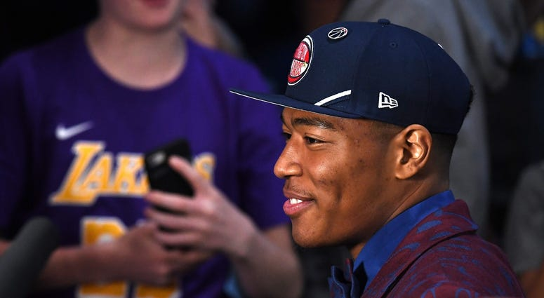 Rui Hachimura reacts after being drafted with the ninth overall pick by the Washington Wizards